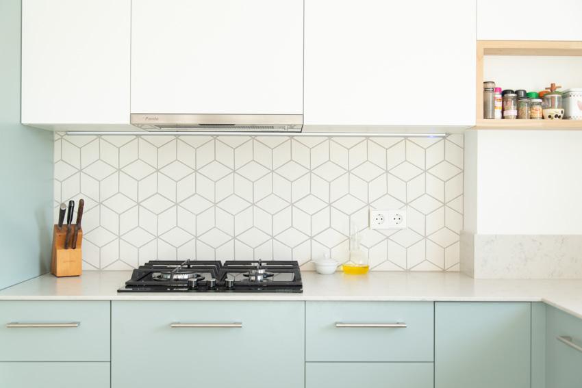 Geometric backsplash countertop light green cabinets kitchen