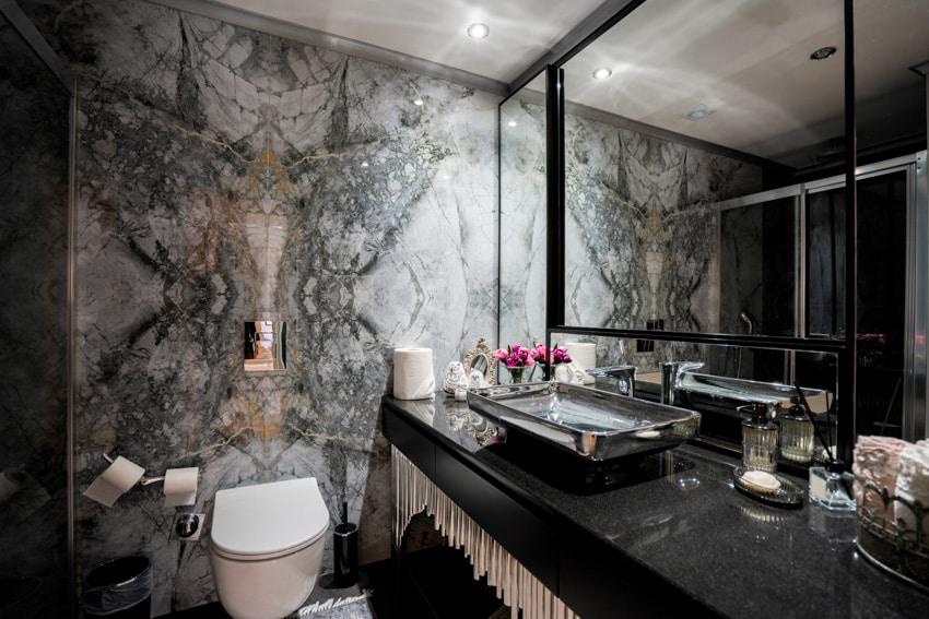 Gray and black bathroom mirror countertop toilet