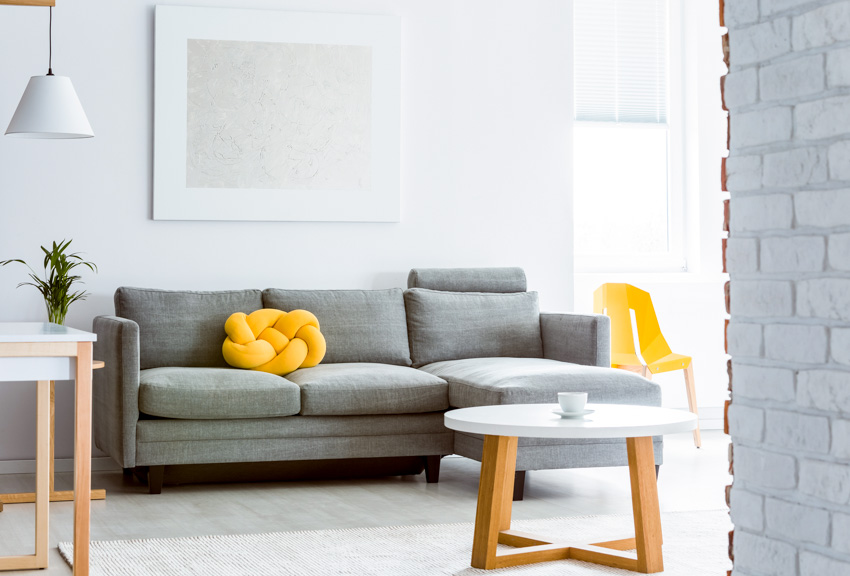 Gray sofa with cushions coffee table window