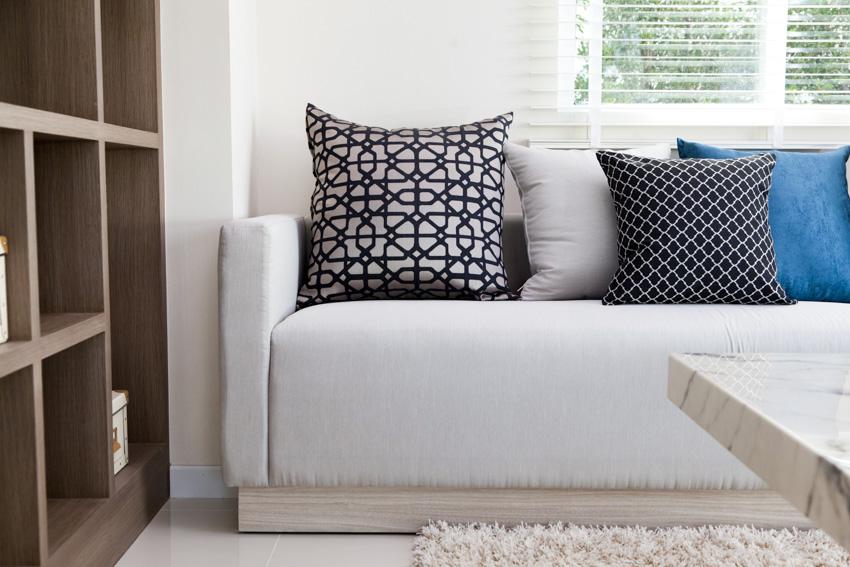 Gray sofa with fixed cushion pillows