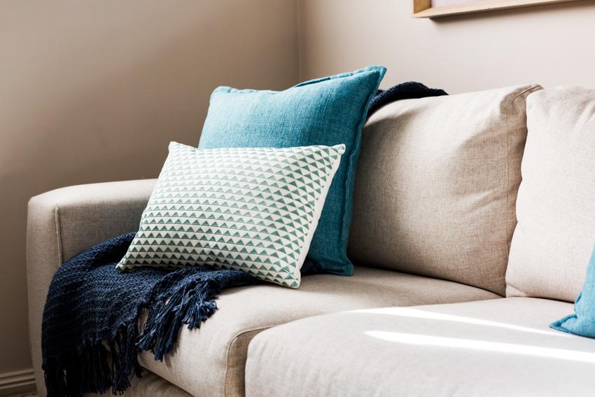 Gray sofa with pillows