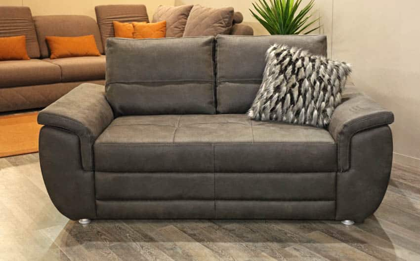 Gray two person recliner sofa with pillow