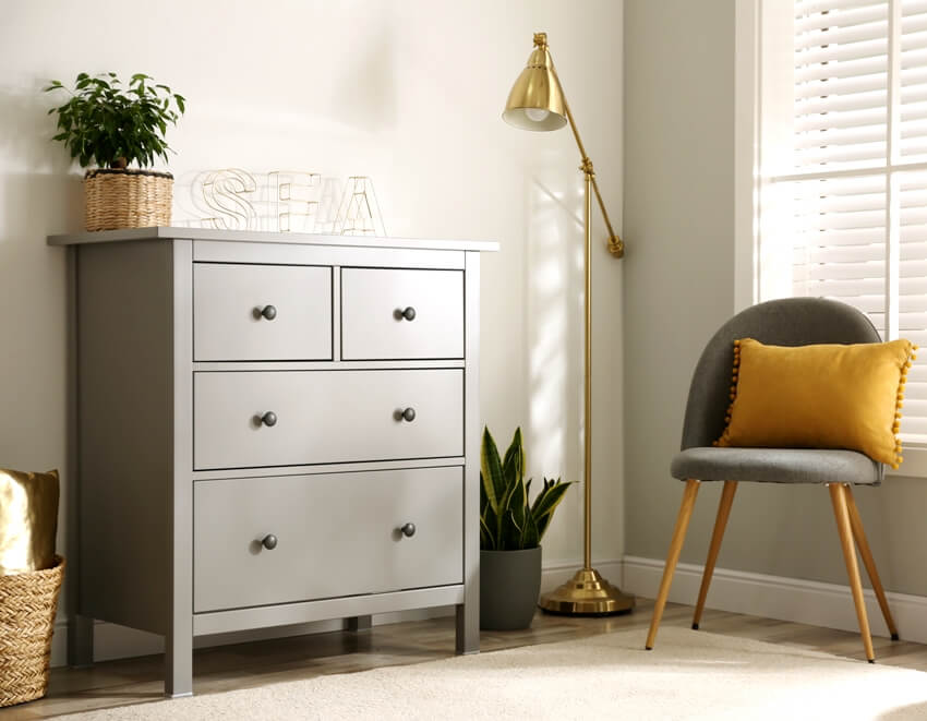 A grey chest of drawers in stylish scandinavian room interior