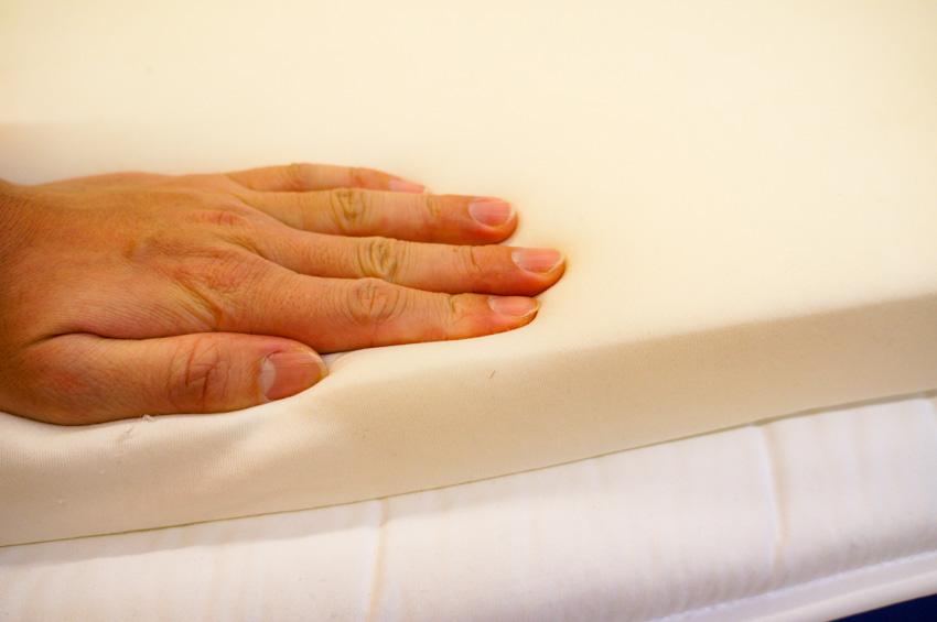 Hand on sofa cushion foam