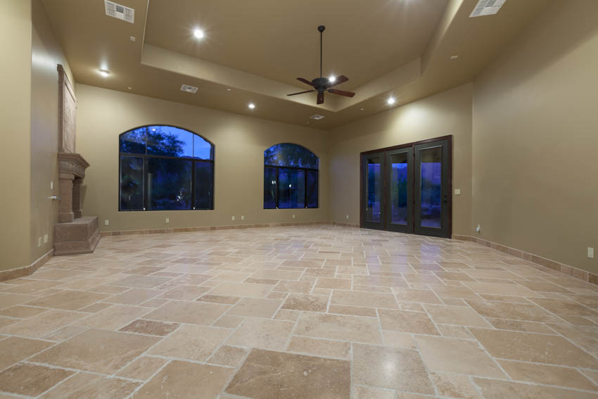 House interior room with travertine tiles ceiling fan beige walls