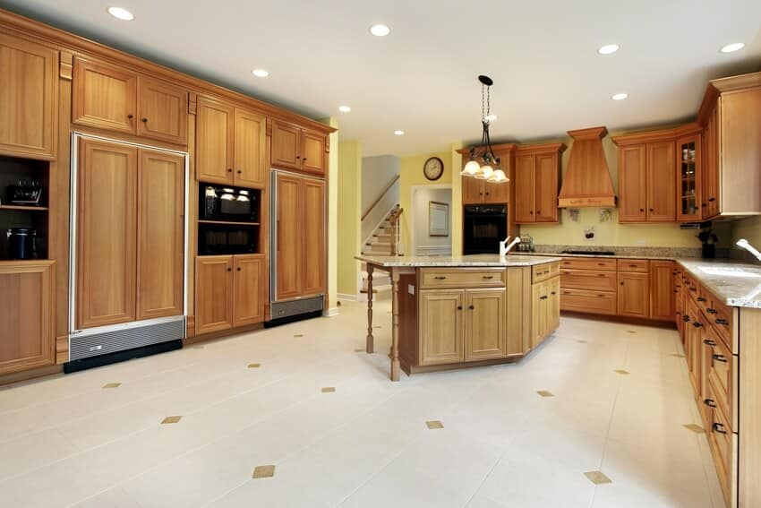 Huge kitchen with wooden cabinets and white tile flooring
