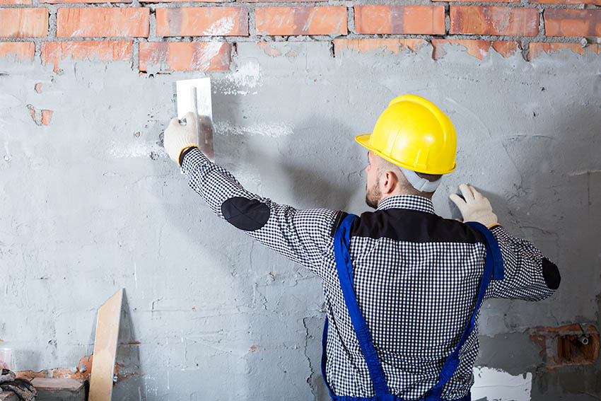 Installing stucco over brick wall