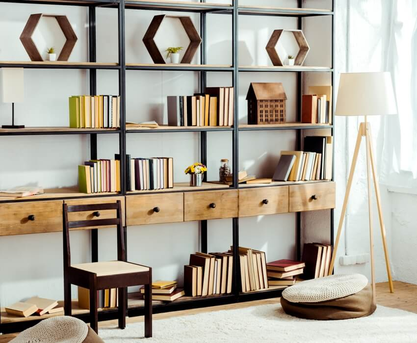 Interior of living room with wooden bookcase and books