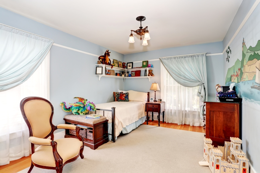 Kids bedroom interior in blue tones with cherry wooden furniture and nice curtains