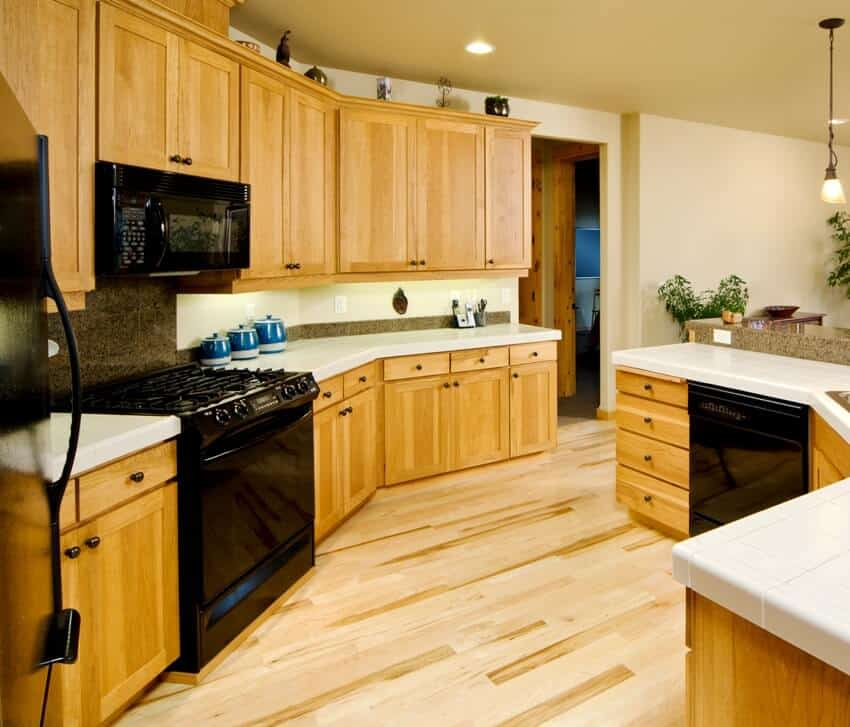Kitchen with maple cabinets and black appliances