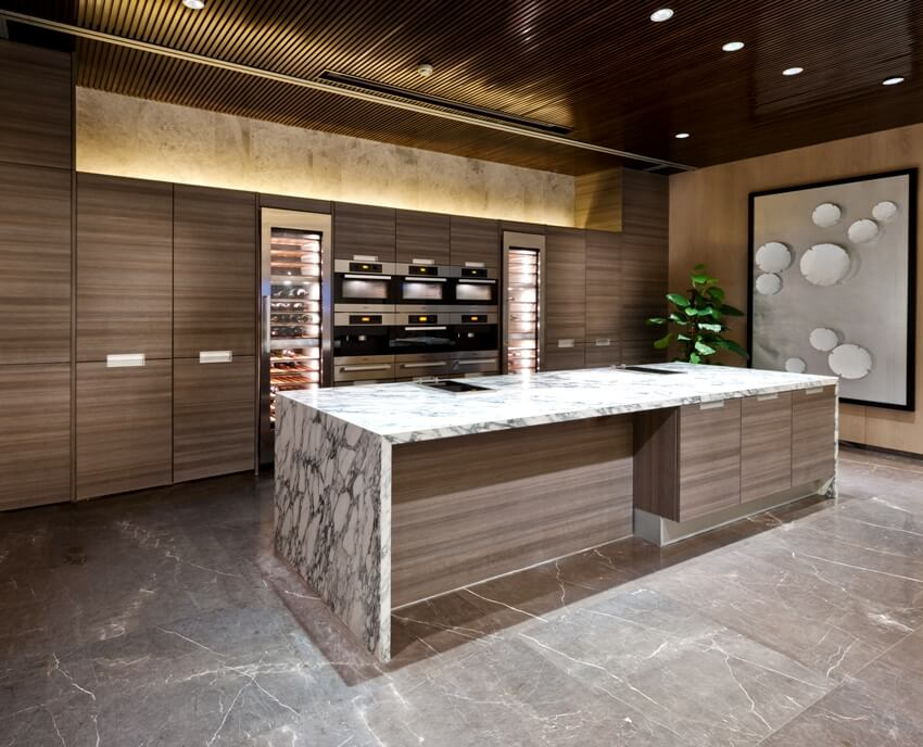 Kitchen area with marble floor kitchen island and wooden walls