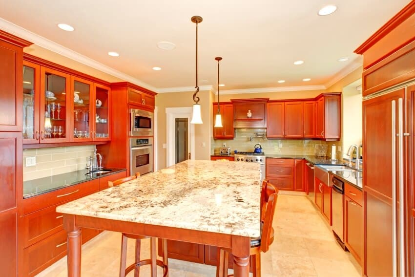 Kitchen interior with beige walls center table with chairs and dark maple cabinets