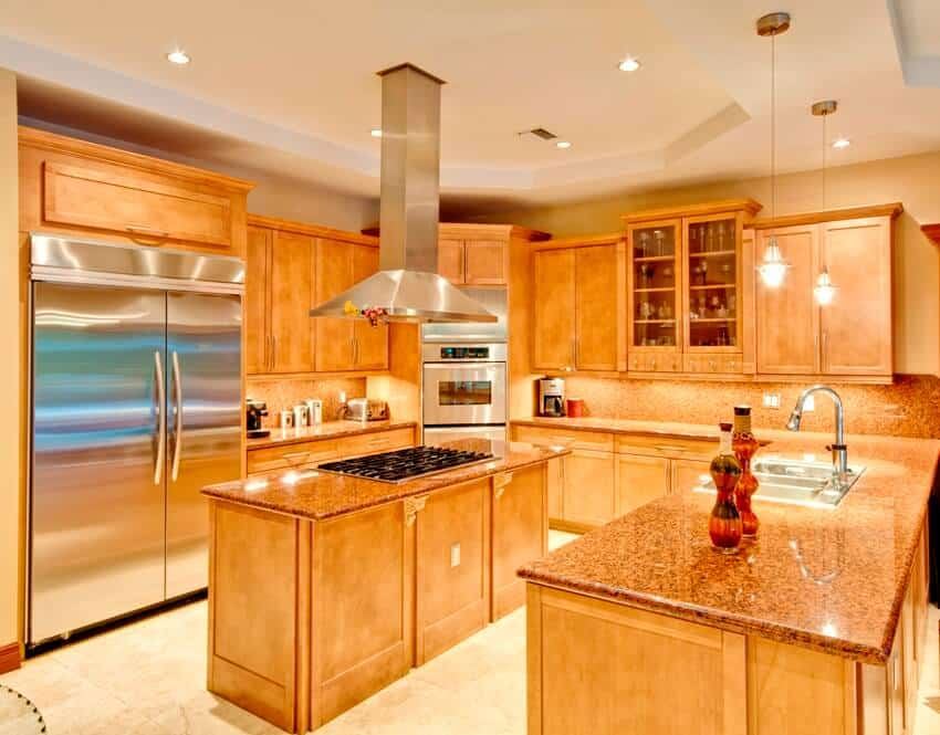 Kitchen interior with maple cabinets, center island and stainless steel appliances