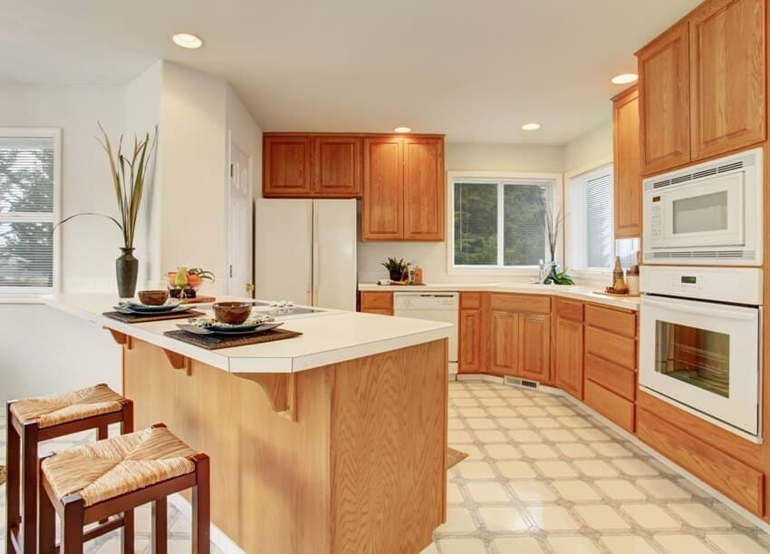 Kitchen interior with tile floor wooden cabinets and white appliances