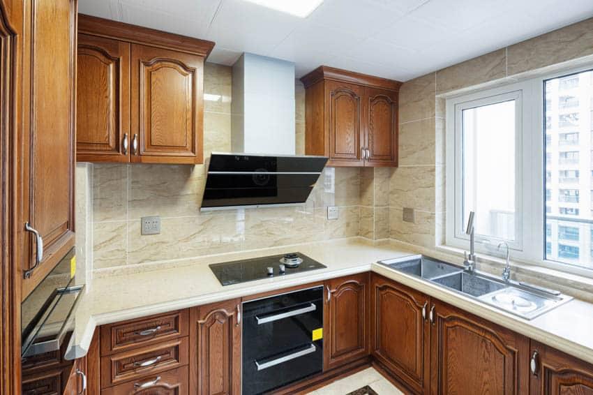 Kitchen maple cabinets white countertop windows