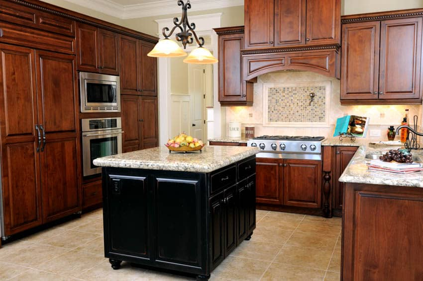 Kitchen with black island cabinets oven countertops