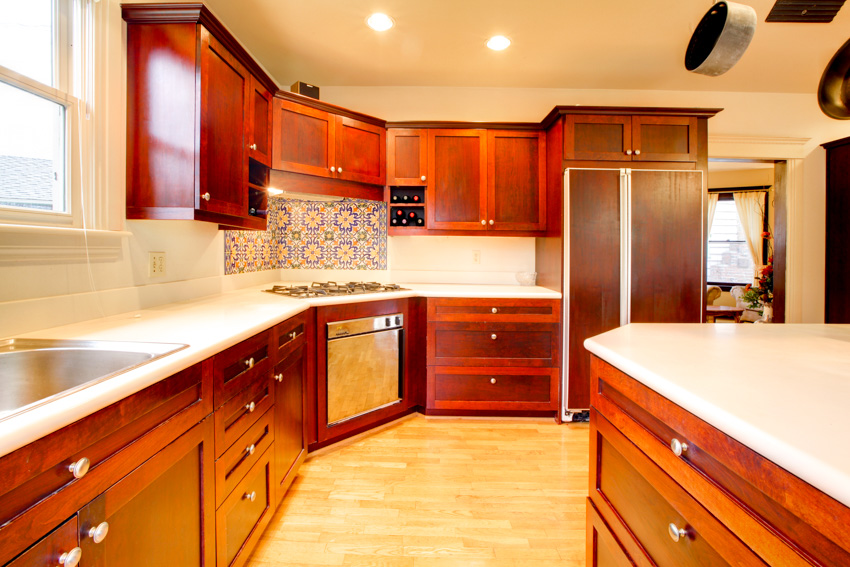 Kitchen with cherry wood drawers and cabinets