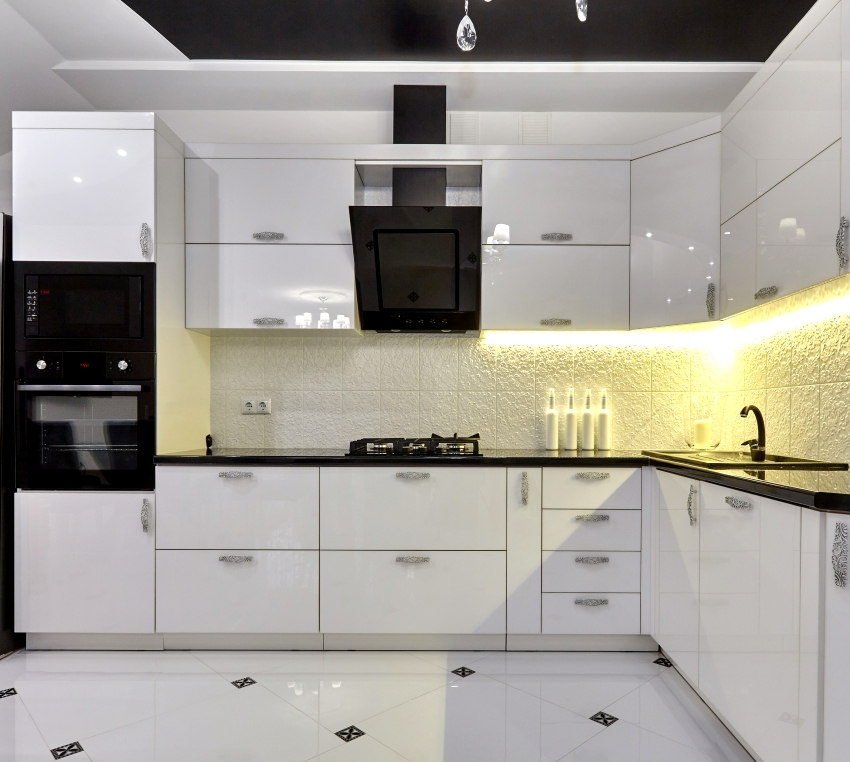Kitchen with double stacked cabinets black appliances and a beautiful interior