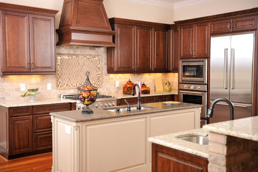 Kitchen with maple cabinetry center island oven appliances sink countertops