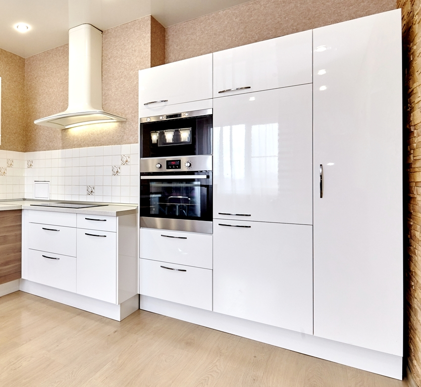 Kitchen with white cabinets and wooden floors