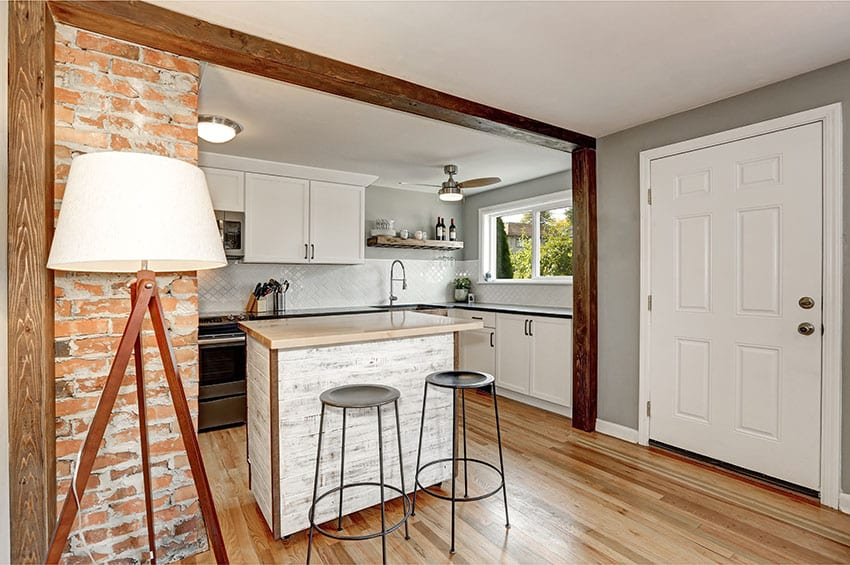 Kitchen with white chalk paint cabinets stool ceiling fan lamp shade