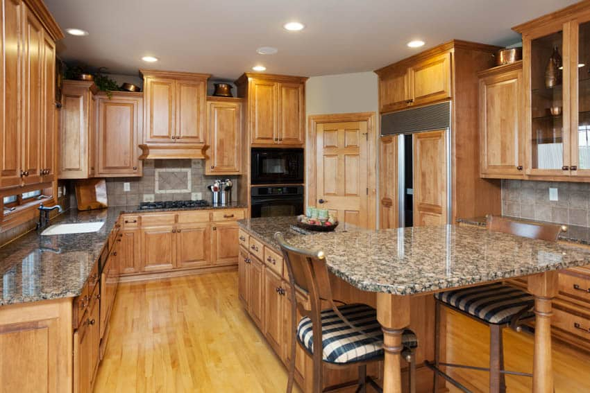 Large kitchen with island for dining countertop maple cabinets