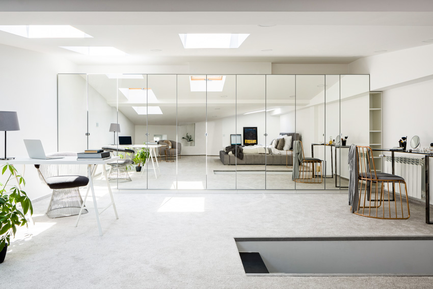 Large mirror panels on wall home office
