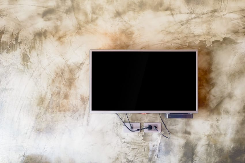 LCD TV mounted on concrete wall