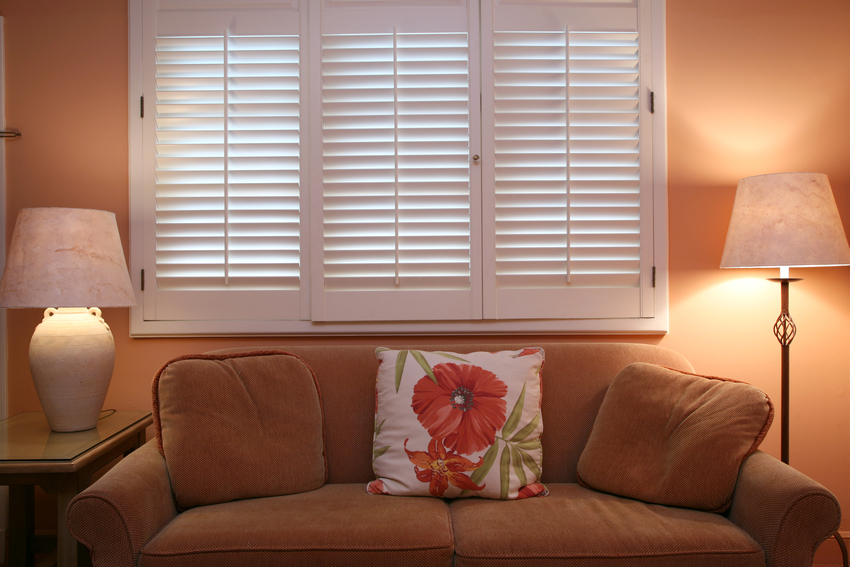 Living room interior with traditional interior shutters