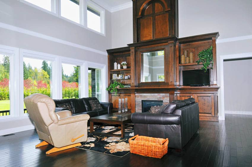 Living room with sofa chairs white recliner glass windows black floor