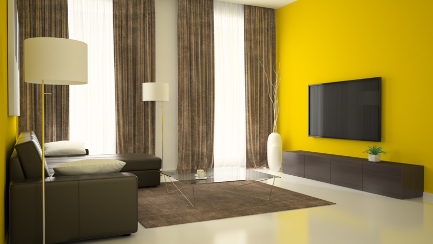 Living room with yellow walls brown curtain television sofa chair lamp