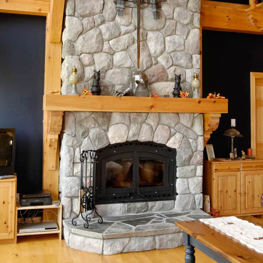 Log cabin with blue walls stone fireplace