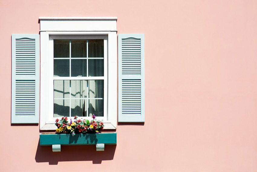 Louvered shutters window pastel pink wall