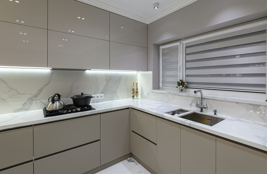 Luxury large modern white marble kitchen with beige handleless cabinets