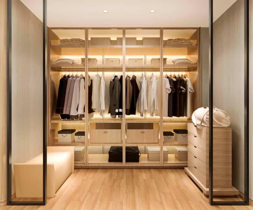 A luxury scandinavian wood walk in closet with wardrobe