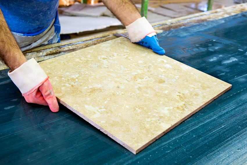Man inspecting travertine tile