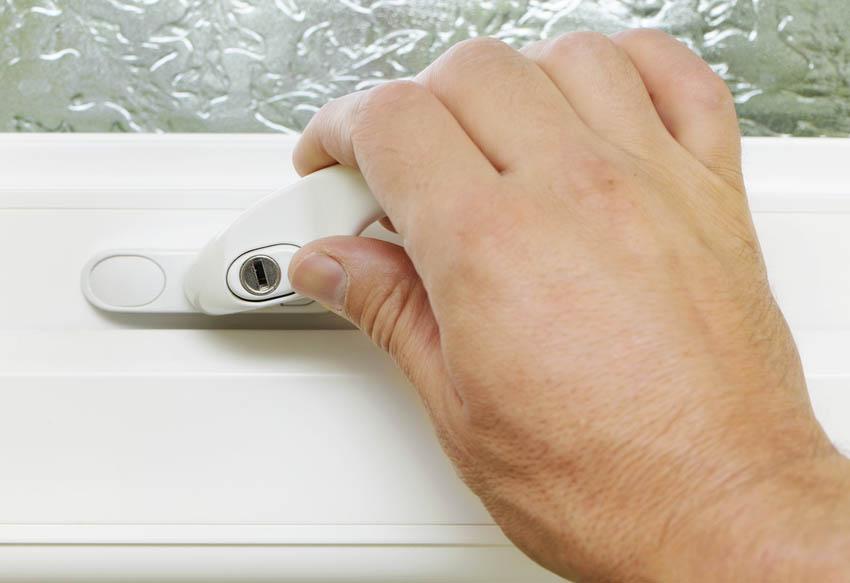 Man opening window lock