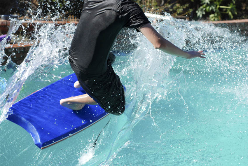 Man surfing in a wave pool