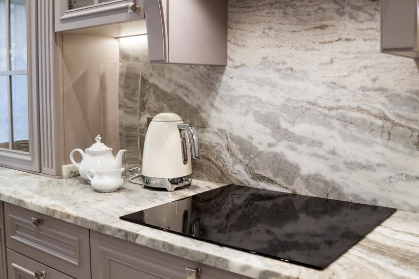 Marble countertop backsplash kitchen appliances electric stove