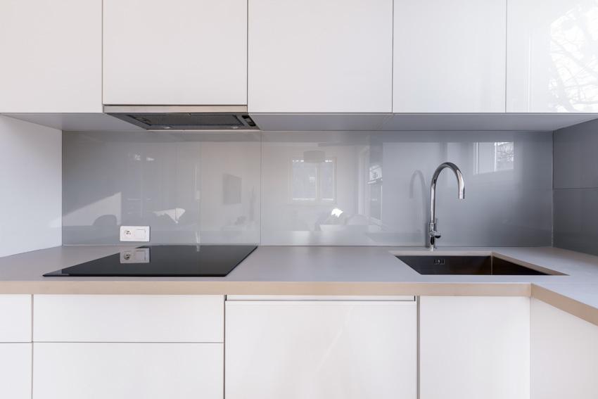 Matching countertop backsplash sink stove white cabinets