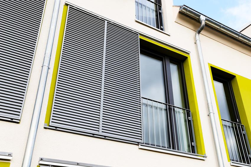 Metal shutters house exterior glass windows