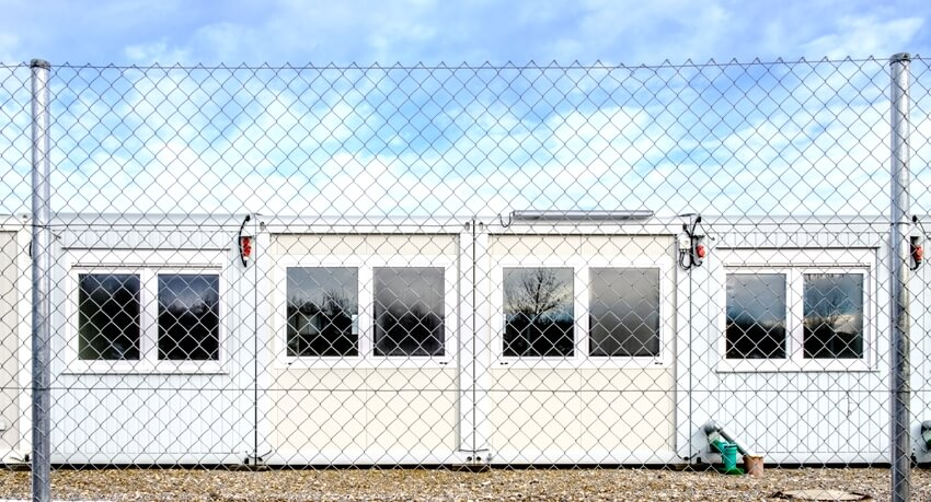 Mobile home container with chain link fence