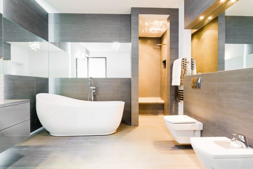 Modern bathroom gray concrete wall mirror bathtub toilet sink