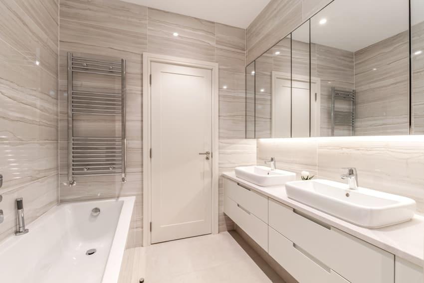 A modern fully tiled clean bathroom interior