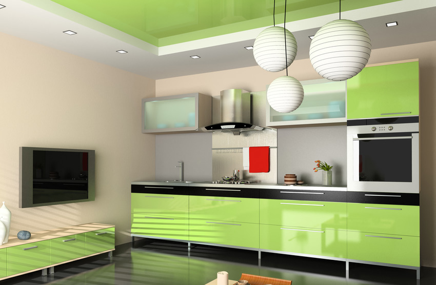 Modern kitchen and living room interior with light green kitchen cabinets