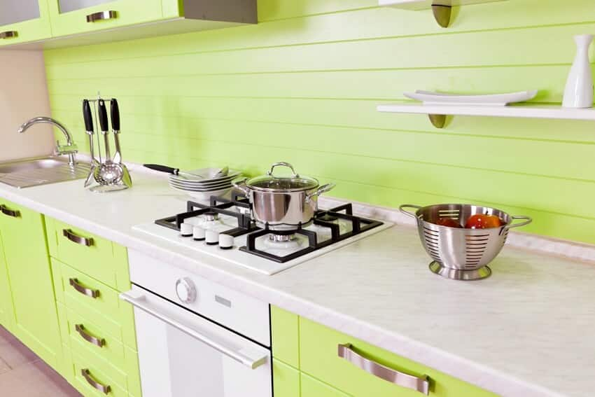 Modern kitchen with bright green cabinets and counter with food preparation