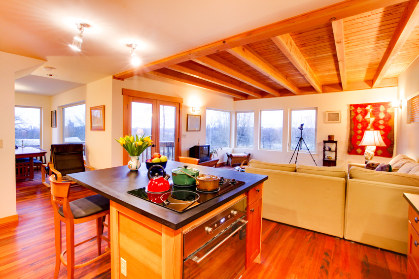 Modern kitchen with cherry wood ceiling and flooring