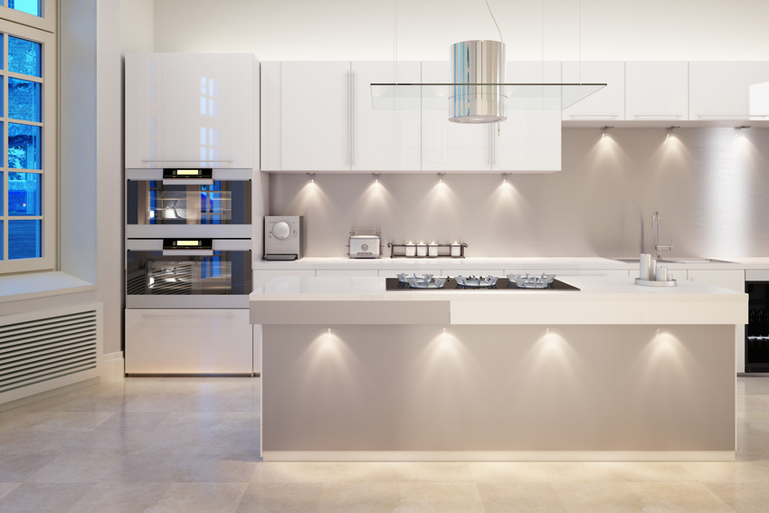 Modern kitchen with classic white kitchen cabinets and various light fixtures