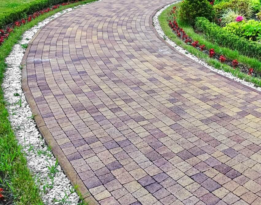 Modern ornamental garden landscape with tiled colorful mosaic cobblestone paving