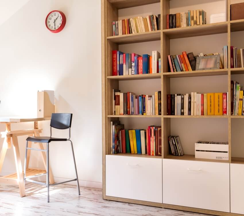 A modern study with a desk and a wooden bookshelf